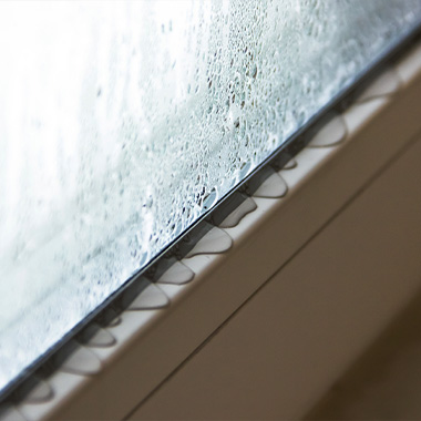 condensations running down glass window and onto the window sill
